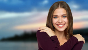 Happy woman in love isolated portrait with crossed arms.